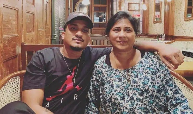 Divine rapper with his mother